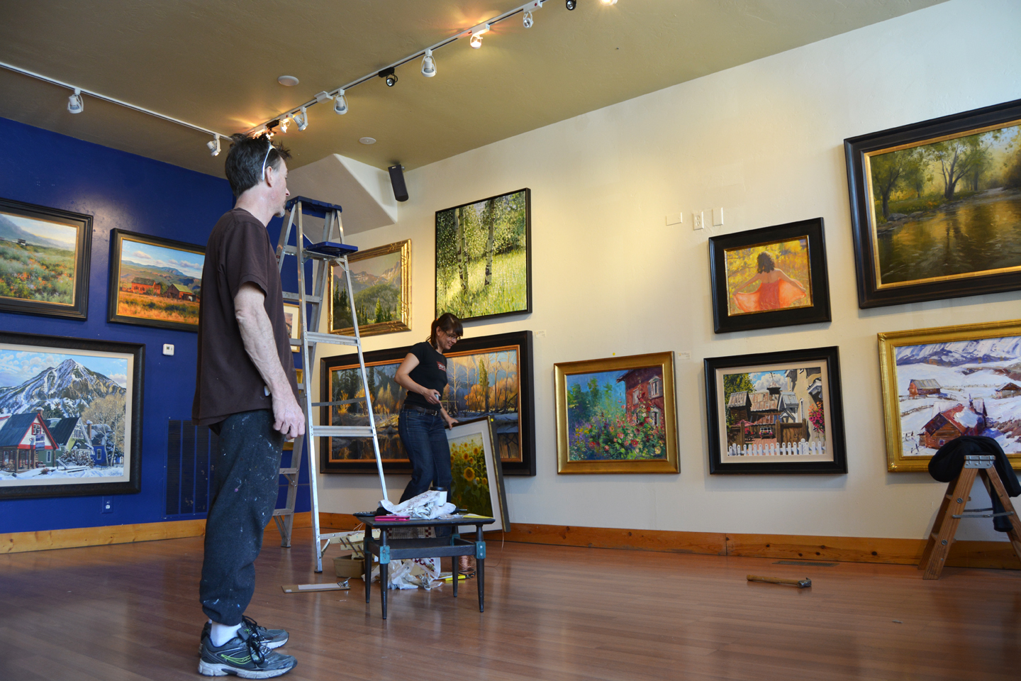 Shaun and Shelley hanging the 2014 Holiday Large Painting Show