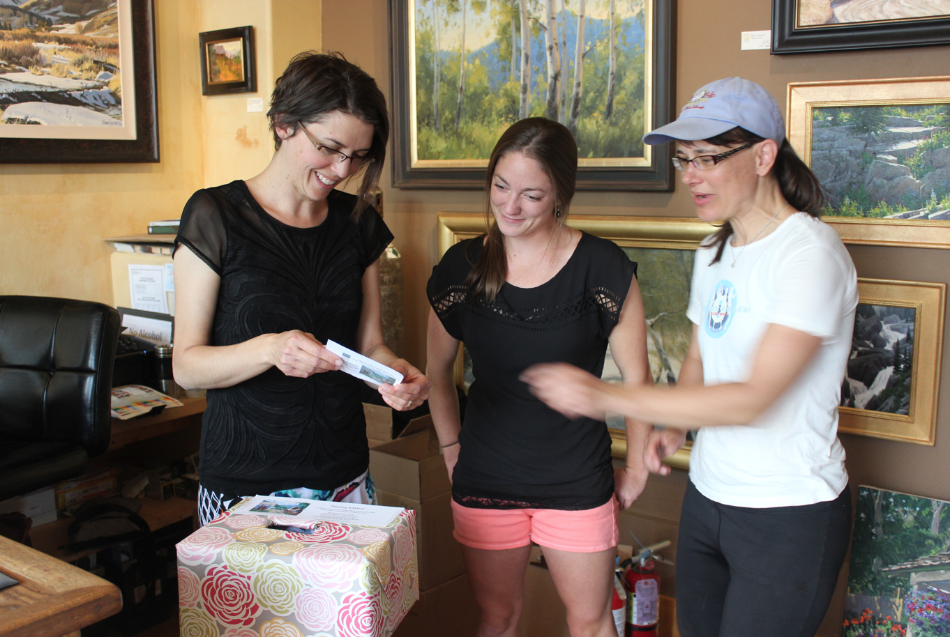 Ivy, Tracy, and Shelley picking the 2014 CBPAI painting raffle winner